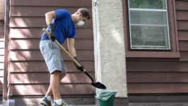 Chris cleaning up the mess left by the raccoons
